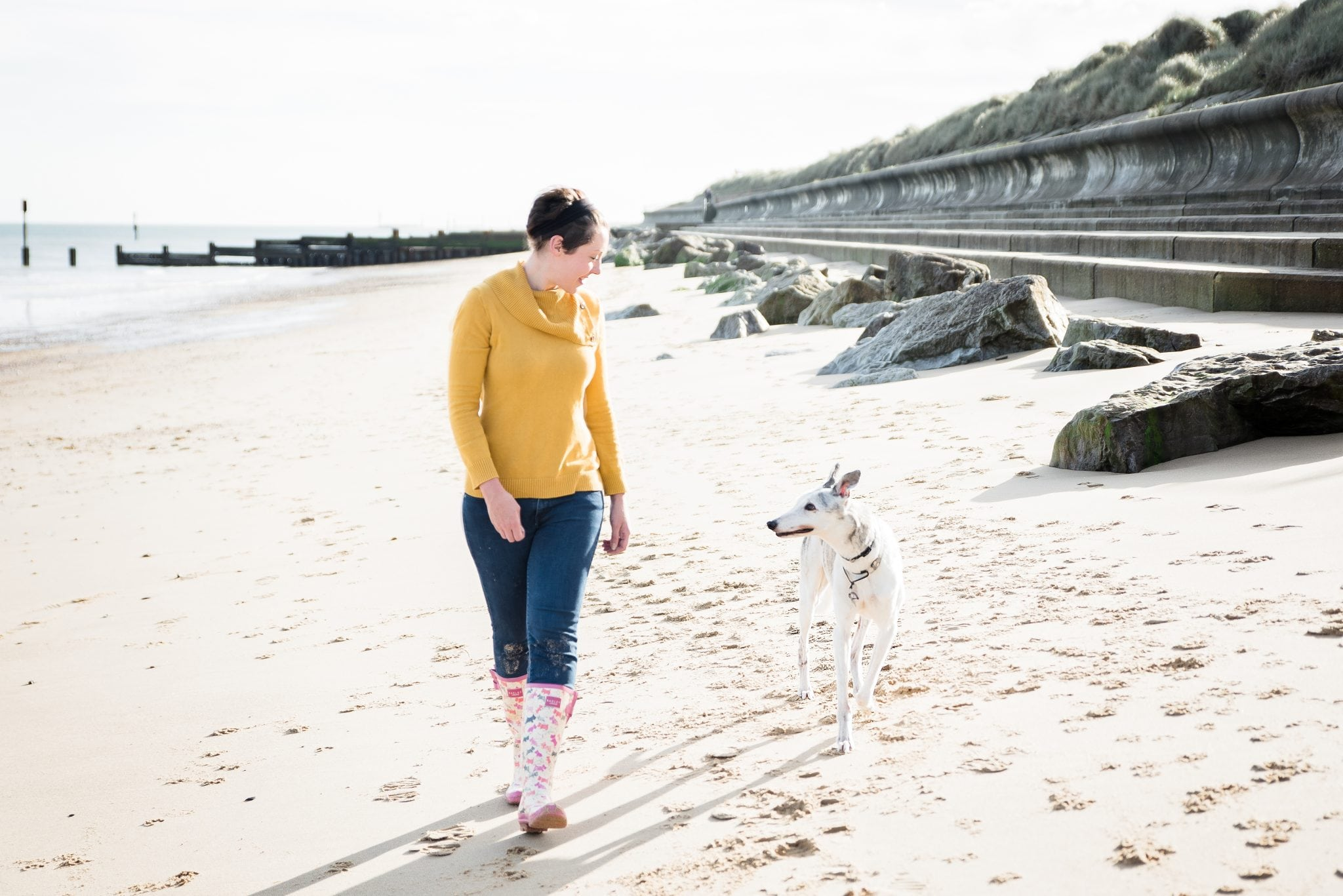 owner-greyhound-on-the-beach